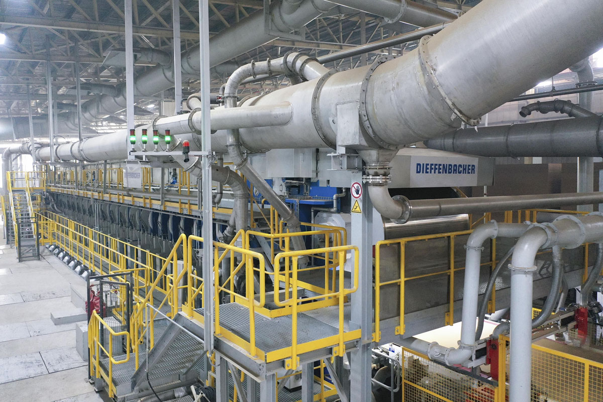 A DIEFFENBACHER CPS+ continuous press in a particleboard plant.